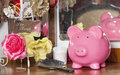 Looking after your money piggy bank on a dressing table Royalty Free Stock Photo