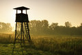 Lookout tower for hunting at dawn Royalty Free Stock Photos