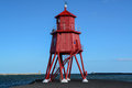 Lookout tower this is a photograph of a newly painted bright red situated at the end of a small pier the is offset by a Royalty Free Stock Photography