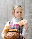 Looks at a bun child Stock Photography