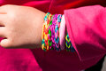Loom band bracelet many bright colored bracelets on the arm of the gums Stock Images