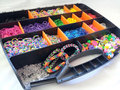 stock image of  Loom band storage box and bracelets