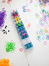 Loom bands and loom band colourful elastic against a white table top Stock Images