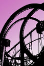 Looping rollercoaster ride on fun fair Royalty Free Stock Photo