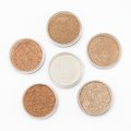 Loose cosmetic powder in jars Royalty Free Stock Image