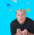 Loosing his marbles a man who is Stock Image