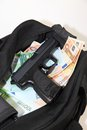 Loot from bank robbery sports bag full of money with gun cut out Stock Photography