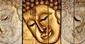 Lord Buddha's face wood carving Stock Photos