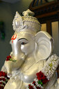 Lord ganesha portrait a statue made from clay plus plaster of paris in white color is beautiful and kept at the entrance of Stock Photos