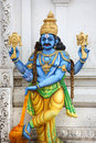 Lord vishnu colorful hindu god statue on temple Stock Images