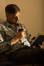 Lorn man relaxing with book photo of bearded Stock Photos