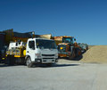 Lorry and bulldozer moving gravel a Stock Photography