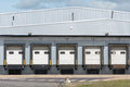 Lorry loading bays at industrial unit and unloading Royalty Free Stock Photography