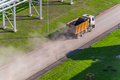 Lorry riding the road and kicking up clouds of dust Royalty Free Stock Photos