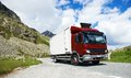 Lorry with trailer driving mountain road cargo truck on highland delivering goods in mountains Royalty Free Stock Photography