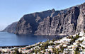 Los gigantes on tenerife spain the second highest cliff coast in europe is the canary island hotel area in foreground Stock Photography