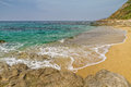 Losari beach in balagne region of corsica sand and rocks on the Stock Image