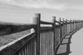 Lose up on wooden fence on the walkway on atlantic coast in black and white, saint jean de luz, basque country, france Royalty Free Stock Photo