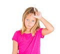 Loser sign gesture closeup portrait angry mad upset pissed young girl displaying with hand on forehead isolated white background Stock Images