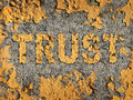 Losing trust deteriorating integrity as business concept represented old fading yellow cracked paint rough cement wall showing Stock Photos