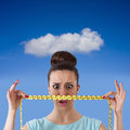 Losing weight expression girl with tape measure concept of Stock Image