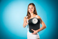 Losing weight young woman with measuring scale diet and loosing a she is happy about the success Royalty Free Stock Images