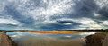 Lossiemouth pano early morning light with dramatic cloud formations over harbour moray firth scotland Stock Photo