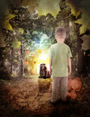 Lost boy in dream woods with bear animal a is standing the on a path looking at a brown bright light at the end for a adventure of Stock Photos
