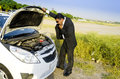 Lost businessman with car breakdown in black suit at countryside Stock Images