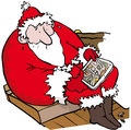 Lost santa father christmas looking at map on a tablet at dawn Royalty Free Stock Photo