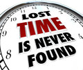 Lost time is never found clock of past history wasted the saying in d words on a white representing the feeling loss when dwindles Stock Images