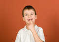 Lost tooth boy portrait on brown Royalty Free Stock Photo