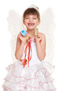 Lost tooth child dressed as tooth fairy with gifts and money Royalty Free Stock Photography