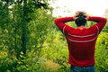Lost young man fonfused in the wild nature Royalty Free Stock Photo
