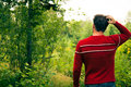 Lost young man fonfused in the wild nature Royalty Free Stock Image