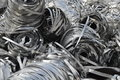 Lot aluminum tape funky metallic strips and stacked for recycling at a recycling plant metal Stock Photos