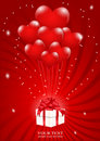A lot of balloons-heart attached to a gift box Royalty Free Stock Photography