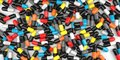 A lot of colorful capsules. 3D rendering on the theme of medicine. Medicines in the form of capsules are piled in a pile Royalty Free Stock Photo