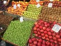 A lot of fruits in boxes in the market with price tags. Royalty Free Stock Photo
