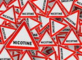 A lot of nicotine triangle road sign