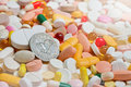 Lot of pills and usa one dollar coin Stock Photography
