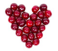 A lot of ripe cherries heart shaped isolated on white background Royalty Free Stock Photos