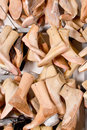 A lot of shoe lasts hanging on rack Royalty Free Stock Photography