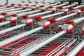 stock image of  A lot of shopping carts with locks standing inserted one into the other