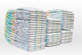 A lot of stacked diapers  on white background Royalty Free Stock Photo