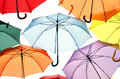 A lot of umbrellas in diverse colors isolated over white background Stock Photography