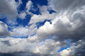 Lot of white clouds on blue sky background Royalty Free Stock Photo