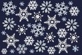 A lot of white snowflake painted with paint through a stencil on a dark blue background. Royalty Free Stock Photo