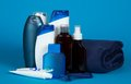 Lotion and foam for shaving a cosmetics set shower towel on blue background Royalty Free Stock Images