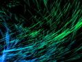 Lots of blue and green particles emission Royalty Free Stock Images
